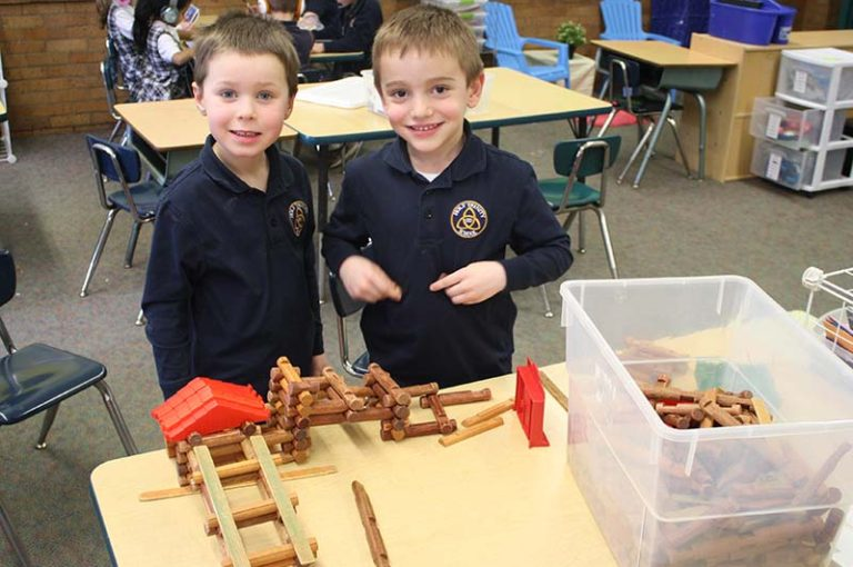 Kids Learning with Lincoln Logs