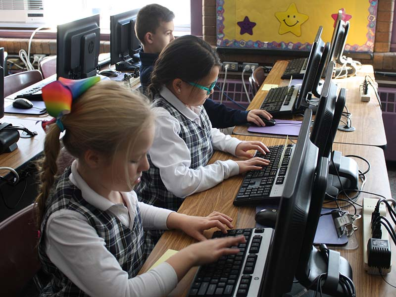Kids Working at Computer Stations