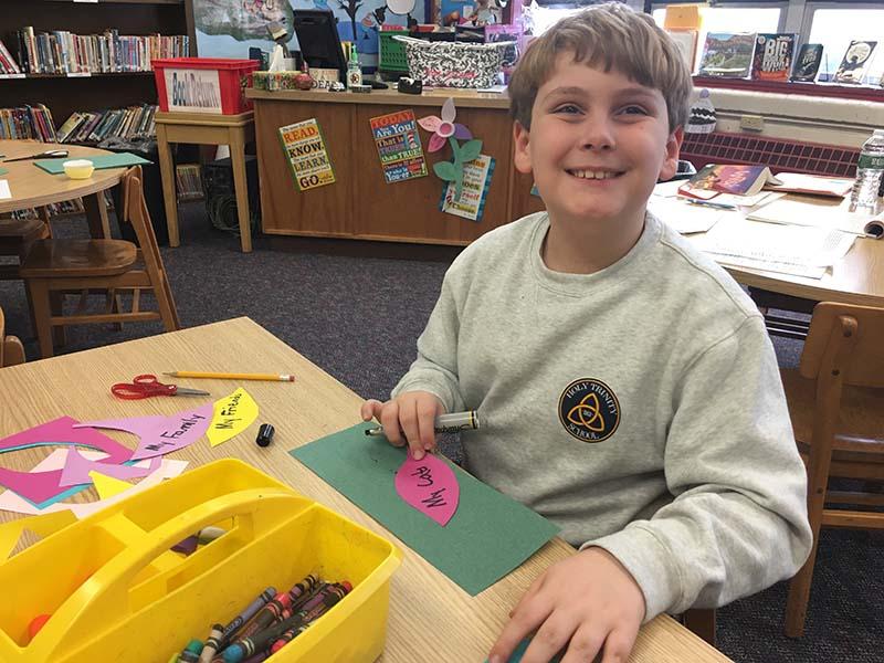 Boy Making a Craft in Class